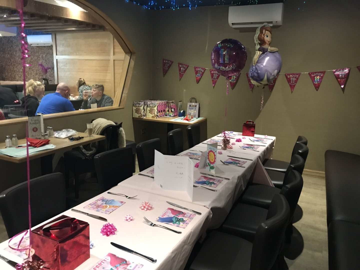 View of venue hire Edinburgh with tables decorated for a birthday party.